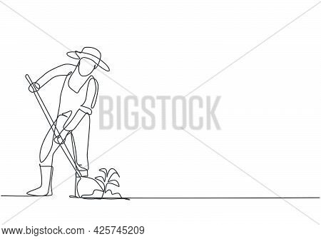 Single One Line Drawing Of Young Male Farmer Shoveled The Soil With The Plants Using A Shovel. Farmi