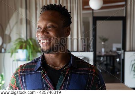 Head Shot Portrait Of Dreamy Smiling African American Businessman