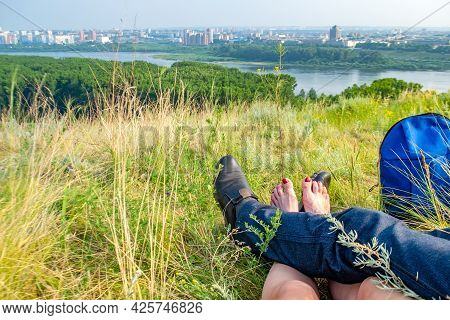 The View Of The Legs Of A Couple In Love, A Girl, A Woman And A Guy, A Man Who Are Resting And Lying
