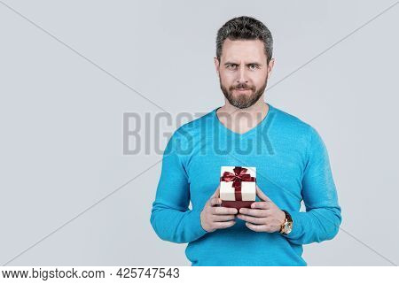 Handsome Mature Man With Beard Holding Present Box, Copy Space, Giftbox