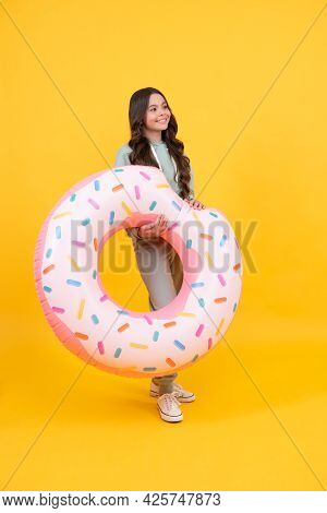 Cheerful Beach Tween Girl With Donut Ring On Summer Vacation On Yellow Background, Summer Holiday.