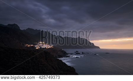 Cliffs In North Coastline Of Tenerife At Moody Sunset. Village In Anaga Mountains, Tenerife, Canary