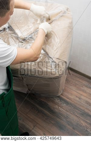 Delivery Worker Opens A Box With A Delivered Cargo With A Knife, Top View
