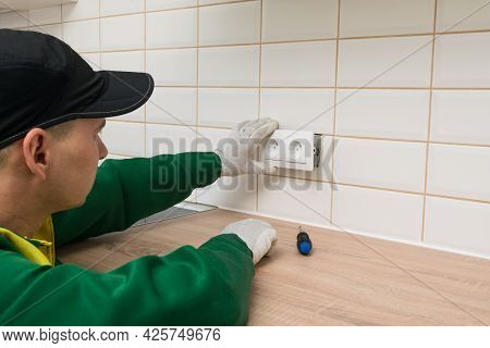 Kitchen Furniture Assembler Finishes The Job By Installing An Electrical Outlet