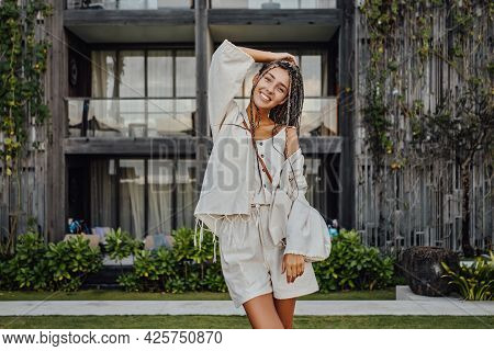Happy Woman In Bali Posing Against Mansion