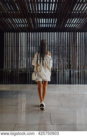 Backview Shot Of Woman In Summer Clothing Inside Room