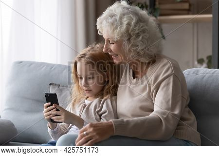 Preteen Girl Grandkid Show Older Granny Funny Photo On Phone