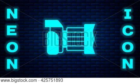 Glowing Neon Photo Camera Icon Isolated On Brick Wall Background. Foto Camera. Digital Photography.