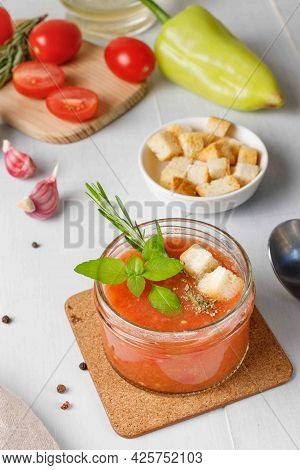 Spanish Gazpacho Soup Is Made From Tomatoes, Cucumbers And Bell Peppers. Served With Croutons And Ba