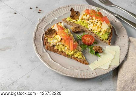 Healthy, Nutritious Sandwiches With A High Protein Content. Rye Bread With Scrambled Eggs, Avocado,