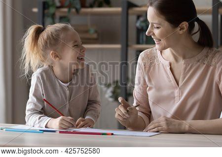 Positive Female Art Teacher Give Drawing Class To Preteen Girl