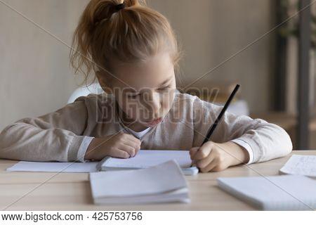 Little Preteen Girl Study Foreign Language Writing Classwork At Desk