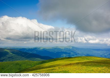 Mountain Meadow In The Afternoon Light. Beautiful Landscape With Clouds Above Horizon. Wonderful Nat