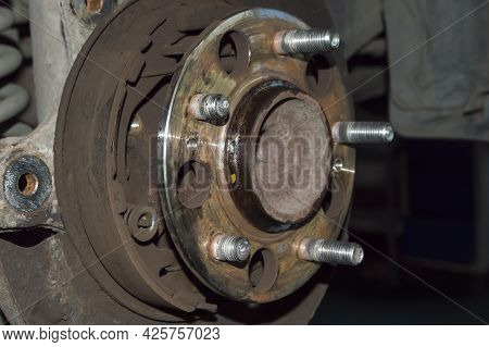 Side View Of The Broken Wheel Studs Installed In The Rear Hub Of The Car