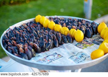 Tray With Boiled Mussels And Lemon. Sale Of Mussels By Piece On The Street. Istanbul, Turkey - 28.07