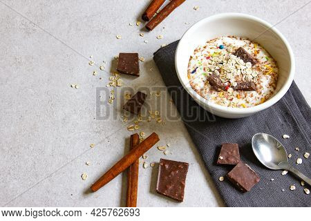 Smoothie Bowl With Natural Yogurt, Chocolate And Cereal On The Grey Background. Healthy Breakfast.
