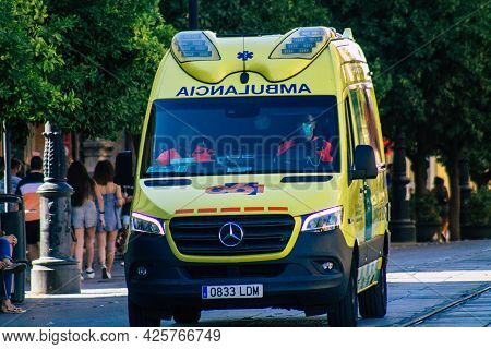 Seville Spain July 02, 2021 Ambulance Driving Through The Streets Of Seville, An Emblematic City And