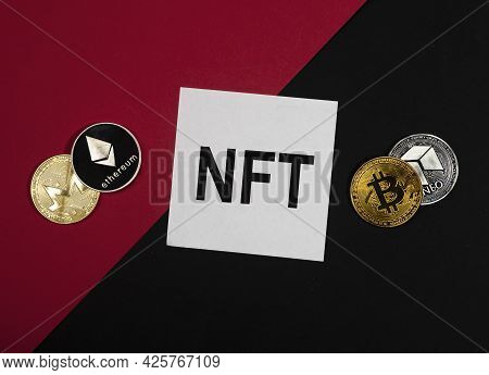 Nft Acronym On Paper Note On Red And Black Background With Cryptocurrency Coins.