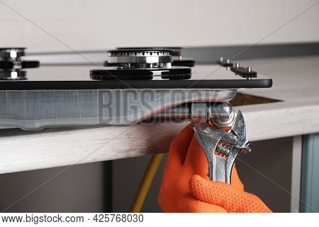 Connecting  Gas Hose To  Hob, Hands With An Adjustable Wrench Close-up