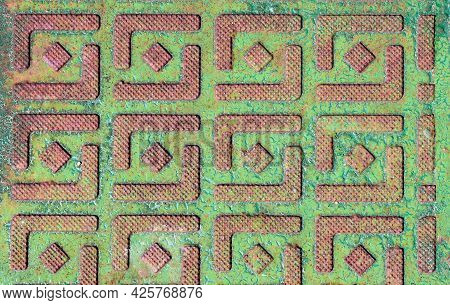Rusty Iron Texture With Cracked Green Paint And Embossed Diamond Pattern.