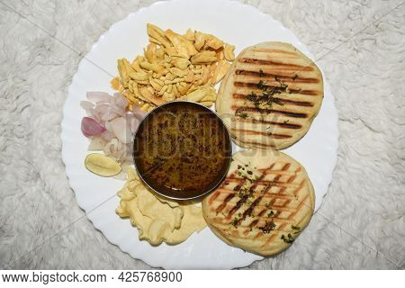 Delicious Misal Kulcha Indian Maharastrian Authentic And Traditional Food Platter Served In White Pl
