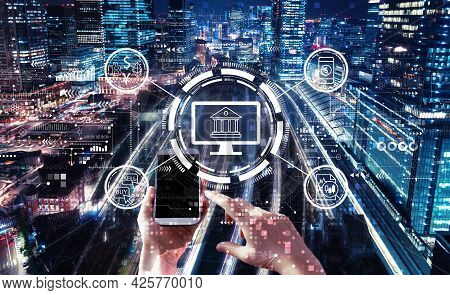 Fintech Theme With Person Using A Smartphone In A Large Train Station