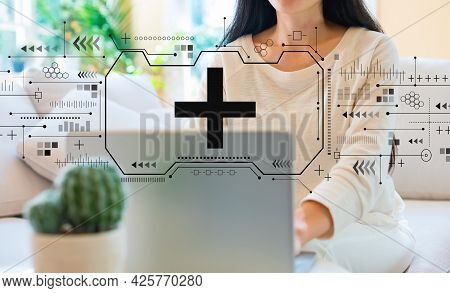 Plus Sign With Woman Using Her Laptop In Her Home Office