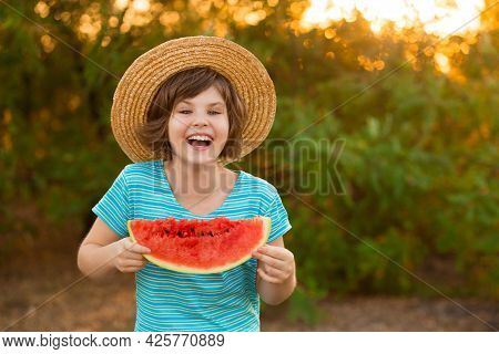 Adorable Baby Girl In Straw Hat Smile And Eagerly Eats Juicy Watermelon With Summer Sunshine On Back