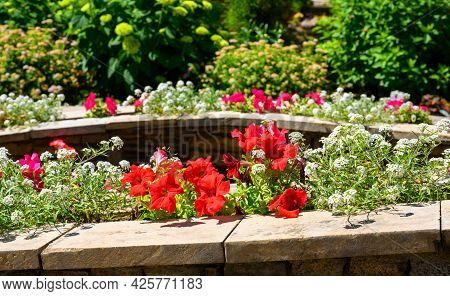 Landscape Design Of Nice Home Garden, Landscaping With Stones And Flowerbeds In Residential House Ba