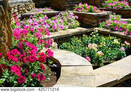Landscape Design Of Nice Home Garden, Landscaping With Stone Tiles And Flowerbeds In Residential Hou