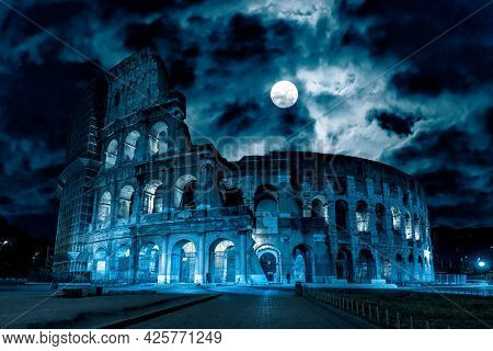 Colosseum At Night, Rome, Italy. Mystery Creepy View Of Ancient Coliseum In Full Moon. Spooky Dark S