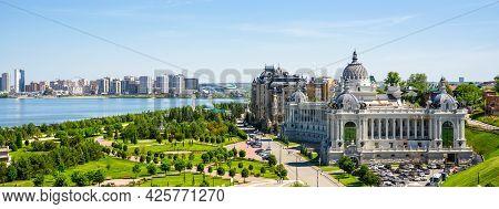 Panorama Of Kazan In Summer, Tatarstan, Russia. View Of Beautiful Green Park And Farmers Palace (min