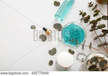 Natural Cosmetics Serum Cream Gel With Eucalyptus Leaves. Skincare Cosmetics Spa Herbal Treatment An
