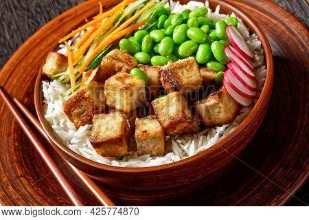 Vegan Tofu Poke Bowl With Basmati Rice, Edamame Beans, Radish, Thinly Sliced Cucumber And Carrots Sa