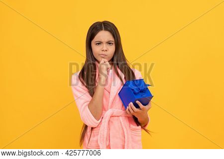 Thoughtful Teen Girl In Home Terry Bathrobe With Gift Or Present Box, Gift