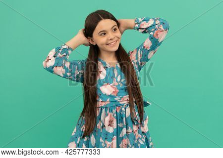Girlhood Dream. Relaxed Girl Blue Background. Happy Child Smile Putting Hands Behind Head. Girlhood