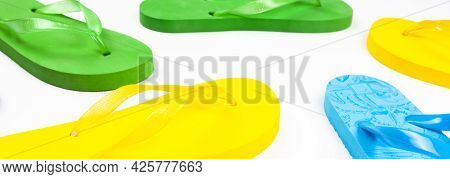 Several Rubber Flop Flops On A White Background, Banner