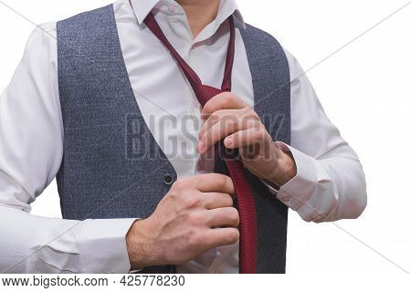 The Man's Hands Are Groomed In A White Shirt And Grey Vest Tied With A Red Tie Close-up.