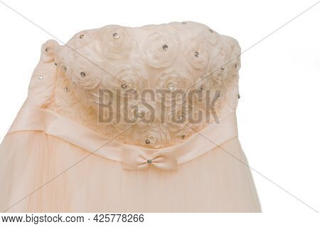 The Bride's Wedding Dress Is Close-up With Rose Pattern And Diamond Decoration On A White Background