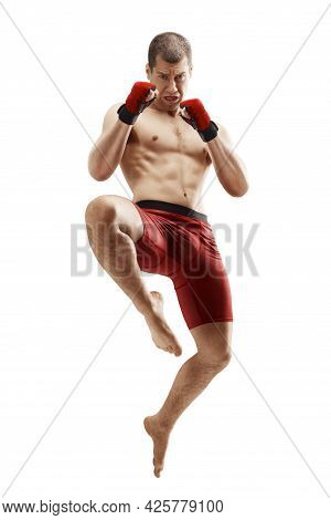 Mma. Jumping Knee Kick. Male Fighter Jumping With A Knee Kick. Straight View. Sport. Isolated