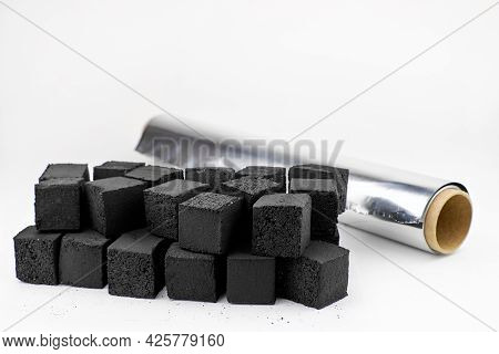 Charcoal And Hookah Foil On A White Background. The Concept Of Preparing A Shisha. A Roll Of Aluminu