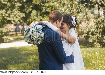 Belarus, Minsk Region - August 11, 2018: Wedding. The Hugs And Tenderness Of The Happy Bride And Gro