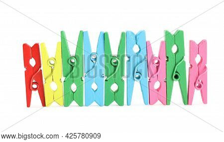Many Colorful Wooden Clothespins On White Background