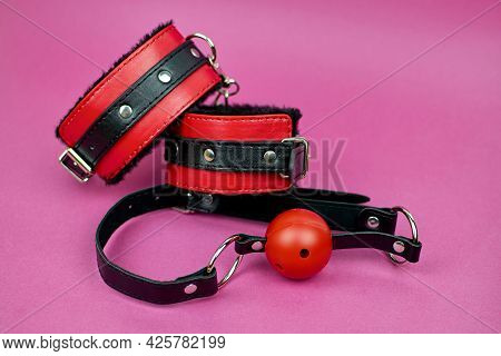 Set Of Erotic Toys For Bdsm, Copy Space. Bdsm Accessories On A Pink Background. The Idea For A Gift