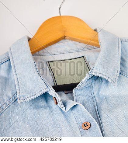Light Blue Denim Shirt, Collar And Button Detail, Close-up Blue Jean Shirt