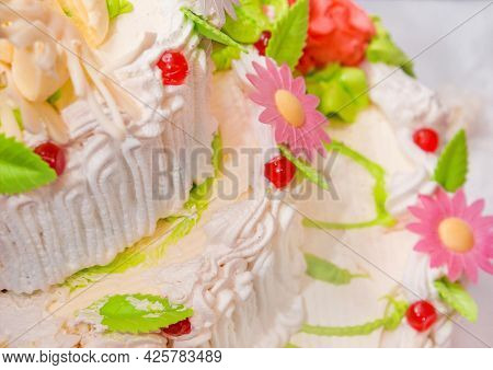 White Cream Cake Decorated With Cherries, Sweet Flowers And Sedated Dessert Leaves Festive.