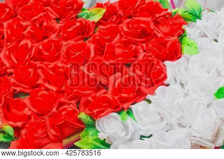Heart Of Red Artificial Roses Opposite White Inanimate Background Flowers.