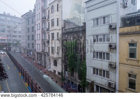 Beyoglu, Istanbul, Turkey - 06.18.2021: One Of Taksim's Street With A Lot Of Buildings During Heavy
