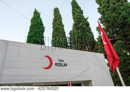 Beyoglu, Istanbul, Turkey - 06.27.2021: Logo Of Turkish Red Crescent (turk Kizilay) On Marble Near T