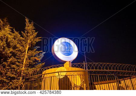 Beyoglu, Istanbul, Turkey - 06.27.2021: Night View Of Logo Of Okcular Vakfi (translation: Organizati